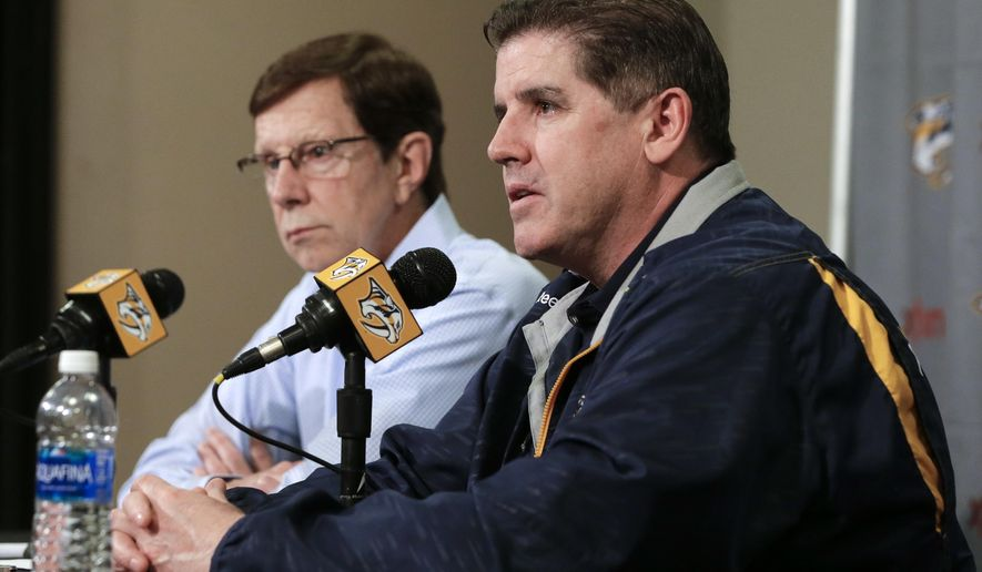 Nashville Predators head coach Peter Laviolette, right, and general manager David Poile answer questions during a news conference Wednesday, May 18, 2016, in Nashville, Tenn. The Predators' season ended after losing to San Jose in the second round of the playoffs. (AP Photo/Mark Humphrey)