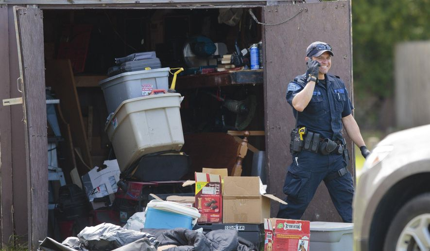 Law enforcement officials execute a search warrant at a home, Wednesday, May 18, 2016, in Norton Shores, Mich. The search is related to the arrest of Jeffrey Willis,  a western Michigan man has been charged with trying to abduct a teenager who needed to make a phone call.  (Joel Bissell/Muskegon Chronicle via AP) ALL LOCAL TELEVISION OUT; LOCAL TELEVISION INTERNET OUT; MANDATORY CREDIT