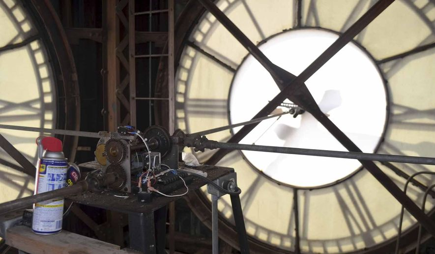 In this photo taken Tuesday, May 17, 2016, the four giant clock faces in the 114-year-old Webster County Courthouse clock tower in Fort Dodge, Iowa are run by a 22-year-old electronic apparatus. The works are no longer keeping the clocks on time, and Webster County is making plans to have the system replaced.  (Joe Sutter/The Messenger via AP) MANDATORY CREDIT