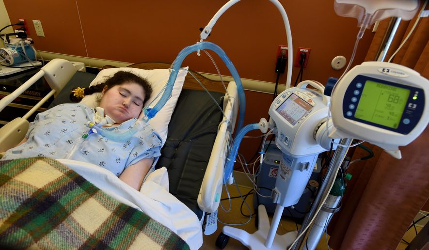 Anahita Meshkin, lies in bed and is hooked up to machines at her care facility in Walnut Creek, Calif., on Tuesday, May 10, 2016. Doctors have determined that Anahita Meshkin, who last year was declared brain dead is still very much alive. She had been in a coma for eight years after suffering a massive seizure while battling anorexia. Doctors wanted to take her off life support machines but her father, Mohammad Meshkin filed a temporary restraining order to block the hospital from withholding Anahita's treatment. (Susan Tripp Pollard/Bay Area News Group via AP)