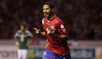 Costa Rica's Alvaro Saborio celebrates after scoring a goal against Mexico during a 2014 World Cup qualifying soccer match in San Jose, Costa Rica, Tuesday, Oct. 15, 2013. (AP Photo/Moises Castillo)