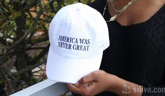 "Visitors to a Staten Island, N.Y., Home Depot were shocked to see an employee wearing an ""America was never great"" hat. (Staten Island Advance video screenshot)"