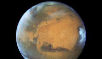 This May 12, 2016, file image provided by NASA shows the planet Mars. (NASA/ESA/Hubble Heritage Team - STScI/AURA, J. Bell - ASU, M. Wolff - Space Science Institute via AP)