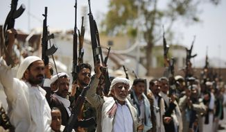 Shiite Houthi tribesmen hold their weapons as they chant slogans during a tribal gathering showing support for the Houthi movement, in Sanaa, Yemen, Thursday, May 19, 2016. On Tuesday the Yemeni Foreign Minister Abdul-Malik al-Mekhlafi announced the suspension of peace talks held in Kuwait with Shiite rebels after weeks of no progress, saying the rebels refuse to accept the legitimacy of the country's internationally-recognized president. (AP Photo/Hani Mohammed)