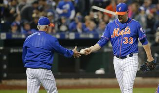 New York Mets manager Terry Collins takes starting pitcher Matt Harvey out of the baseball game during the third inning against the Washington Nationals on Thursday in New York. (AP Photo/Frank Franklin II)
