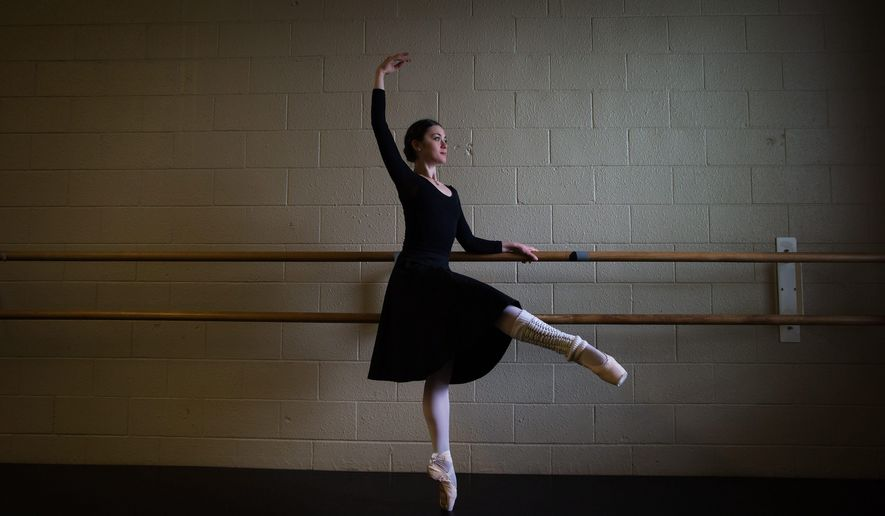 Ballerina Lucila Munaretto, from Argentina, poses for a photograph during a break from rehearsal at Coastal City Ballet in Vancouver on Thursday, May 19, 2016. Nine months after suffering brain and spine injuries, Munaretto is about to resume her ballet career. The young dancer will perform for about 45 minutes in a production of Swan Lake on Saturday in Vancouver. (Darryl Dyck/The Canadian Press via AP) MANDATORY CREDIT