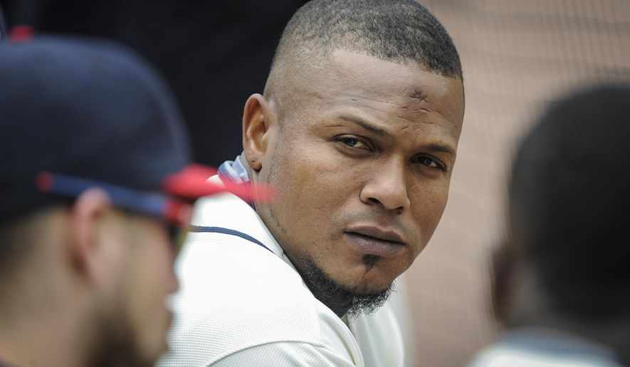 FILE - In this April 10, 2016, file photo, Atlanta Braves shortstop Erick Aybar talks to other players in the dugout during a baseball game against the St. Louis Cardinals in Atlanta. Braves removed Aybar from the starting lineup for Thursday's game against the Pittsburgh Pirates after getting a chicken bone stuck in his throat. (AP Photo/John Amis, File)