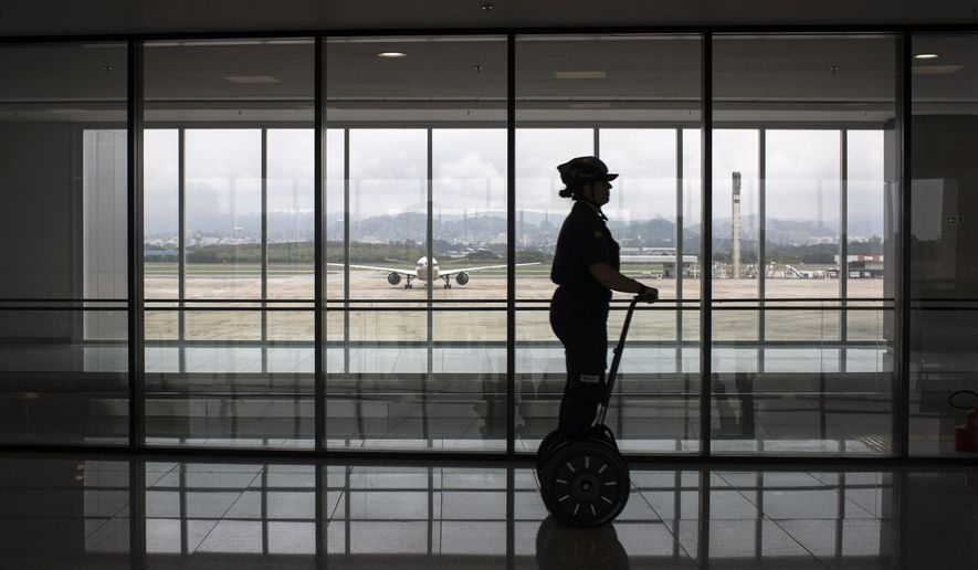 A security worker rides a Segway inside the new area of Terminal 2 at Tom Jobim International Airport in Rio de Janeiro, Brazil, Thursday, May 19, 2016. As part of airport improvements ahead of the 2016 Olympic Games, over two dozen new boarding bridges were added to Terminal 2. (AP Photo/Felipe Dana)