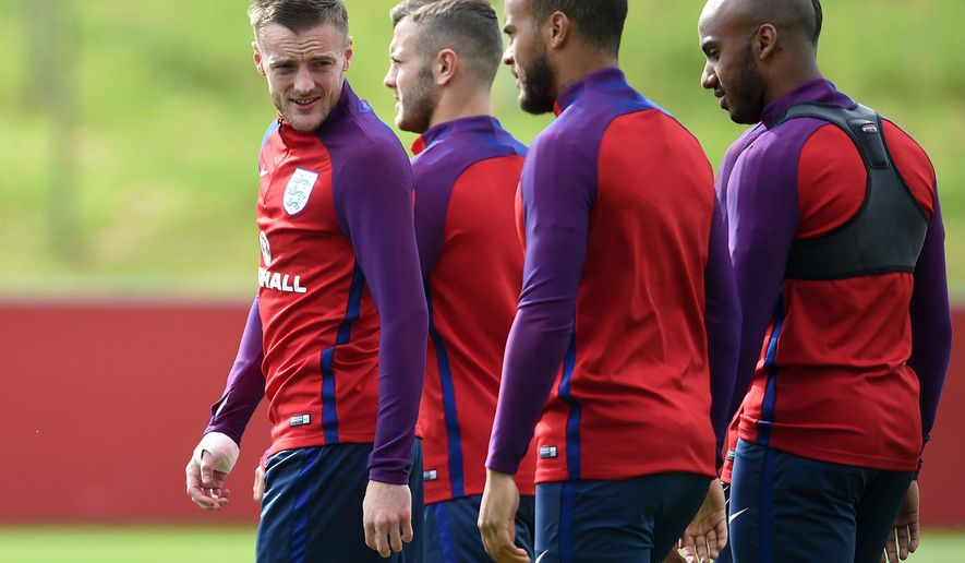 England's Jamie Vardy, left, looks on during a training session at St George's Park, Burton, England, Wednesday, May 18, 2016. England will play an international soccer friendly against Turkey on Sunday, May 22, (Joe Giddens/PA via AP)      UNITED KINGDOM OUT      -      NO SALES      -     NO ARCHIVES