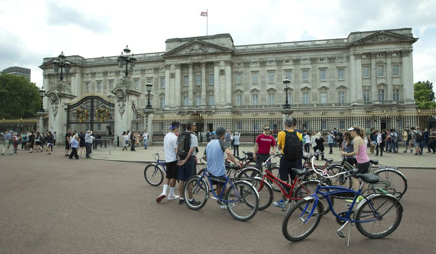 FILE - This is a  Wednesday, June 24, 2015 file photo of Britain's Queen Elizabeth II's official London residence Buckingham Palace .  British police said that they have arrested a man who scaled a wall and got into the grounds of Buckingham Palace. The Metropolitan Police force says a 41-year-old man was detained in the palace grounds in the evening of Wednesday May 18, 2016  on suspicion of trespassing on a protected site.(AP Photo/Alastair Grant, File)