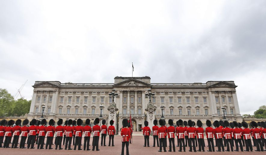 Guardsmen parade out Buckingham Palace  before Britain's Queen Elizabeth II travels in a carriage to the Houses of Parliament in London, Wednesday, May 18, 2016. The Queen will give a speech to parliament above the government's programme for the upcoming parliamentary year .(AP Photo/Frank Augstein)