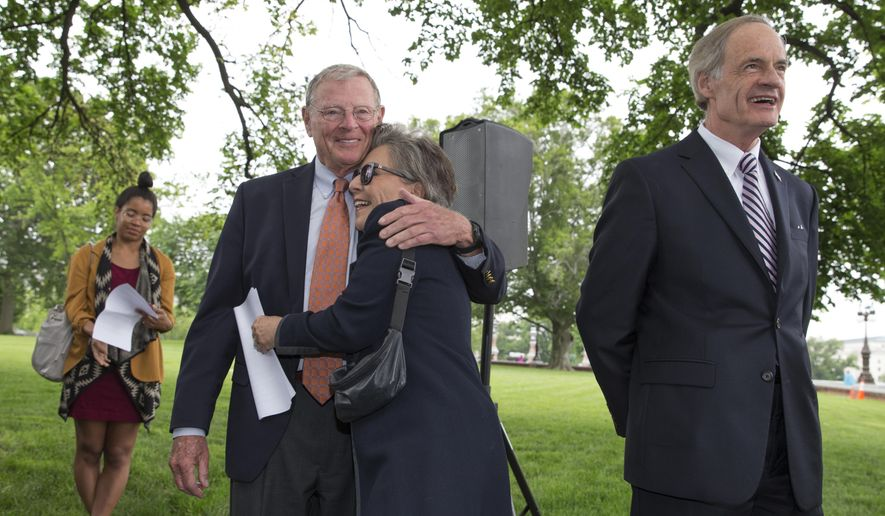Sen. Barbara Boxer, D-Calif., embraces Senate Environment and Public Works Committee Chairman Sen. James Inhofe, R-Okla., on Capitol Hill in Washington, Thursday, May 19, 2016, during a news conference to discuss bipartisan legislation to improve the federal regulation of chemicals and toxic substances. Sen. Tom Carper, D-Del. is at right. (AP Photo/J. Scott Applewhite)