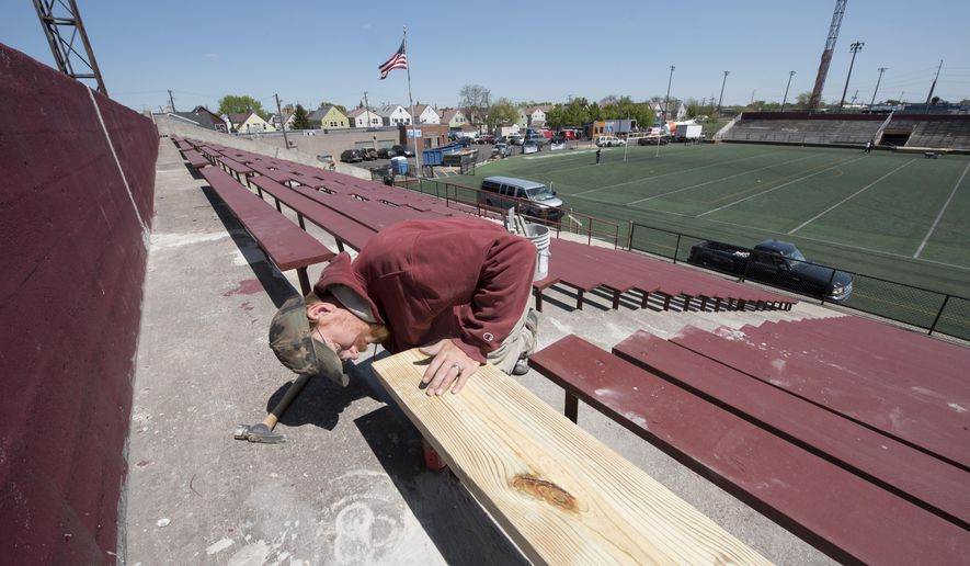 Carpenter Kevin Holtquist installs new wood for the bleachers during repairs Wednesday, May 18, 2016 during the renovation taking place at Keyworth Stadium in Hamtramck, Mich., in preparation for the first season of Detroit City FC soccer that will play there. (David Guralnick/The Detroit News via AP)