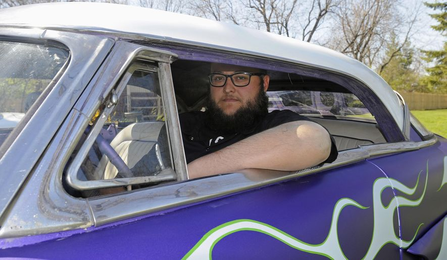 ADVANCE FOR USE SUNDAY, MAY 22 AND THEREAFTER - In this April 15, 2016 photo, Bourbonnais resident Steve Coats II sits in his current work-in-progress car in Bourbonnais, Ill. Coats learned to love cars as a child, in his father's garage. He got his first vehicle when he was 12, a 1967 Chevy pickup. Since then he's had over 40 others. (Tiffany Blanchette/The Daily Journal via AP) MANDATORY CREDIT