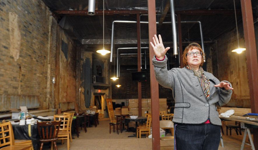 ADVANCE FOR USE SATURDAY, MAY 21 AND THEREAFTER - In this April 27, 2016, photo, Keri Perkins, secretary of the Momence Theatre Friends non-profit organization, talks about the restoration progress inside the 1920s-era theatre in Momence, Ill. Perkins said the non-profit is still seeking donations for the home stretch of the project. (Tiffany Blanchette/The Daily Journal via AP) MANDATORY CREDIT