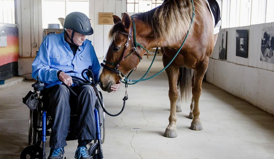 ADVANCE FOR USE SUNDAY, MAY 22 AND THEREAFTER - In this May 3, 2016, photo, R.B. McAllister of Woodstock, Ill., walks a horse after taking a riding lesson at Main Stay Therapeutic Farm in Richmond, Ill. Main Stay, which works with disabled children and adults, has undergone major renovations with some brand new facilities. It is a nonprofit organization that serves adults and children with special needs through therapeutic riding, equine and animal-assisted and adaptive garden programs. (Sarah Nader/Northwest Herald via AP) MANDATORY CREDIT; CHICAGO TRIBUNE OUT