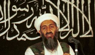 Osama bin Laden is seen at a news conference in Khost, Afghanistan, in this 1998 file photo made available on March 19, 2004. (AP Photo/Mazhar Ali Khan, File) ** FILE **
