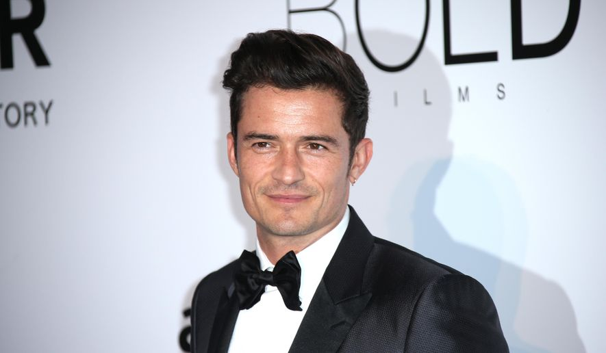 Actor Orlando Bloom poses for photographers upon arrival at the amfAR Cinema Against AIDS benefit at the Hotel du Cap-Eden-Roc, during the 69th Cannes international film festival, Cap d'Antibes, southern France, Thursday, May 19, 2016. (AP Photo/Joel Ryan)