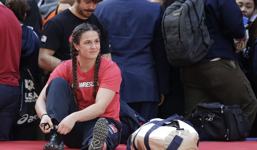 Adeline Gray prepares to compete in the Beat the Streets international wrestling exhibition in Times Square, Thursday, May 19, 2016, in New York. Three months from now in Rio, Gray hopes to become the first American woman to win Olympic gold in the sport and inspire more girls to take up wrestling. (AP Photo/Julie Jacobson)