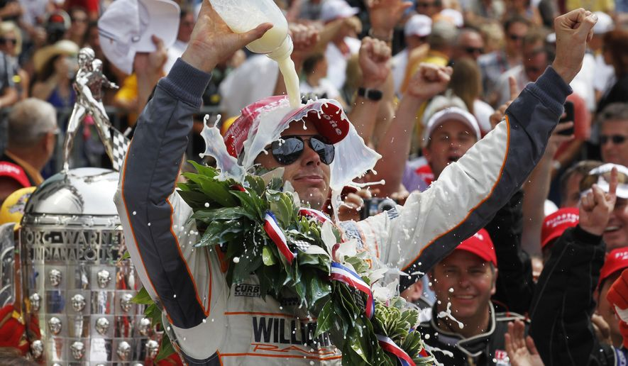 FILE - In this May 29, 2011, file photo, IndyCar driver Dan Wheldon, of England, douses himself with milk after winning the Indianapolis 500 auto race at the Indianapolis Motor Speedway in Indianapolis. The unusual beverage choice, after a race that lasted hours, was embraced by dairy farmers and has become one of the most unique traditions in sports. (AP Photo/Darron Cummings, File)