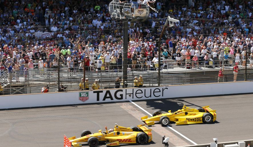 FILE - In this May 25, 2014, file photo, Ryan Hunter-Reay celebrates after crossing the finish line, taking the checkered flag in front of Helio Castroneves, of Brazil, to win the 98th running of the Indianapolis 500 IndyCar auto race at the Indianapolis Motor Speedway in Indianapolis. (AP Photo/Dave Parker, File)