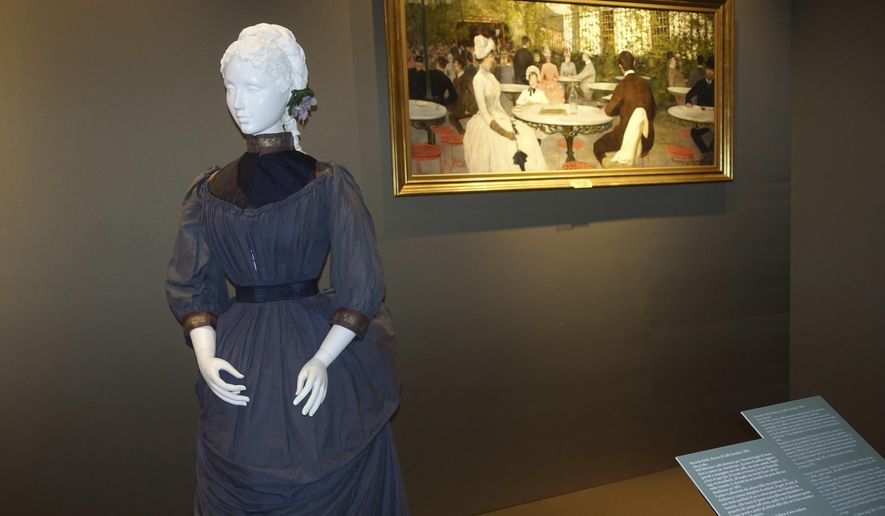 "In this photo taken on Tuesday, May 17, 2016, a Parisian haute couture walking dress from around 1884 is pictured alongside a period painting from the Uffizi Gallery's Galleria di Arte Moderna collection depicting the fashion of the era, on display at Pitti Palace in Florence, Italy, as part of the ""Across Art and Fashion'' series of exhibits at locations throughout Florence. The exhibit opened Thursday as Italy's Renaissance capital is reclaiming its centuries-old role as an incubator of the fashion-art dynamic.(AP Photo/Colleen Barry)"