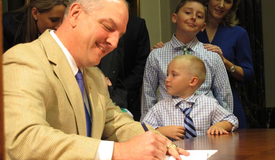 Louisiana Gov. John Bel Edwards signs a bill to expand and jump-start Louisiana's medical marijuana program, on Thursday, May 19, 2106, in Baton Rouge, La. (AP Photo/Melinda Deslatte)