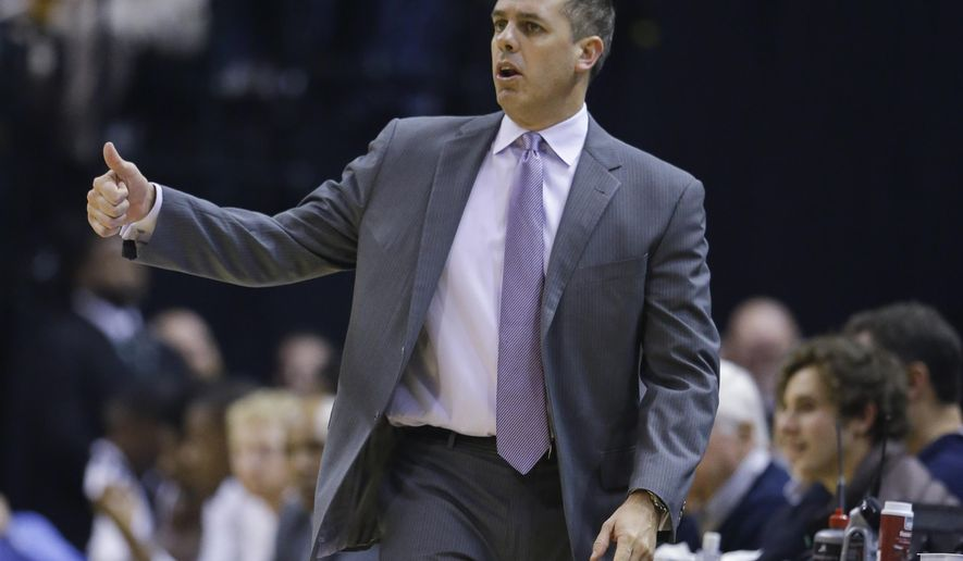 FILE - In this Dec. 8, 2015, file photo, Indiana Pacers coach Frank Vogel gestures during the first half of the team's NBA basketball game against the Golden State Warriors in Indianapolis. A person with knowledge of the negotiations says the Orlando Magic have agreed to a deal with Vogel to be the team's next head coach. The person says the Vogel and Magic officials met during the day Thursday, May 19, 2016, and reached a deal, which will not be final until Friday afternoon. The person spoke to The Associated Press on condition of anonymity because the Magic have not announced the hire. The Pacers did not renew Vogel's contract after the season. (AP Photo/Michael Conroy, File)