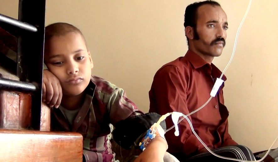This image made from video taken on May 7, 2016 shows, Feras Ali Hassan, a 10-year-old who is being diagnosed with leukemia, left, and his father Ali Hassan, waiting in front of a clinic in Taiz. Yemen's civil war has wreaked massive destruction and created a humanitarian disaster in what was already the Arab's world's poorest country. Taiz, one of the worst battlegrounds, has seen another level of misery: The city of around 400,000 is home to Yemen's largest cancer hospital, the Amal Hospital, and the war has doomed hundreds of its patients to death because they are unable to get treatment. Hassan, was diagnosed with leukemia at the age of 6, had seen improvement over two and a half years of treatment at Amal. But for months, his father couldn't get him to treatment because the family lived in a frontline district, Wadi Hanish. (AP Video via AP)