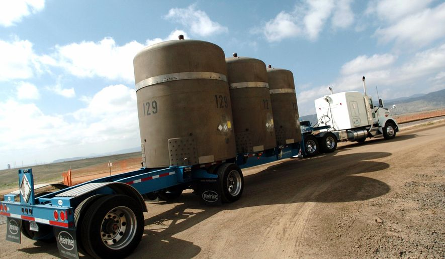 FILE -- In this April 19, 2005, file photo, the last of shipment of high-level radioactive waste is driven away from the former Rocky Flats nuclear weapons plant in Golden, Colo. Attorneys say they reached a $375 million settlement late Wednesday, May 18, 2016, in a legal battle between the operators of the former nuclear weapons plant outside Denver and thousands of homeowners who said plutonium releases from the plant hurt their property values.  It must still be approved by a federal judge, and it could take months to set up a process for homeowners to file claims.  (Sammy Dallal/The Daily Camera via AP, file) MANDATORY CREDIT