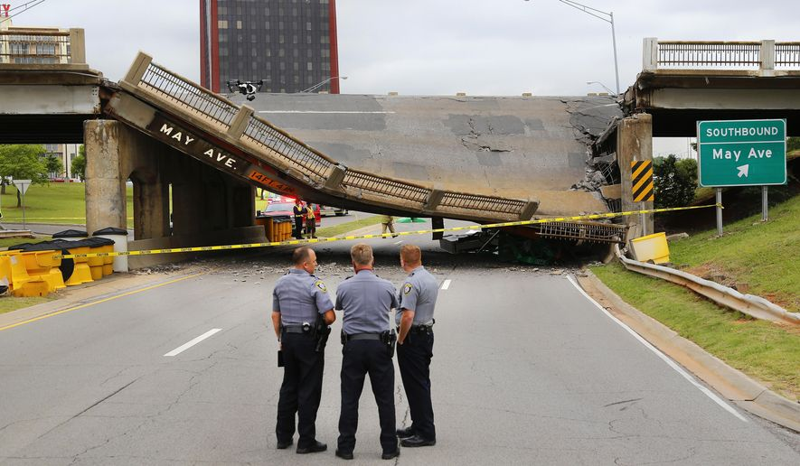 A section of the May Avenue bridge above the Northwest Expressway collapsed when  it was hit by a truck, Thursday, May 19, 2016, in Oklahoma City. This view is looking east on the Expressway. No injuries were reported. (Jim Beckel/The Oklahoman via AP)