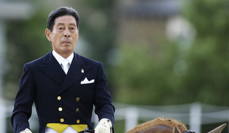 FILE - This is a Thursday, Aug. 2, 2012,  file photo of Hiroshi Hoketsu from Japan as he rides Whisper in the equestrian dressage competition, at the 2012 Summer Olympics in London.  Hiroshi Hoketsu a 75-year-old Japanese equestrian athlete will not be able to become the oldest competing Olympian of all time in Rio de Janeiro because of an illness to his horse. (AP Photo/Markus Schreiber, File)