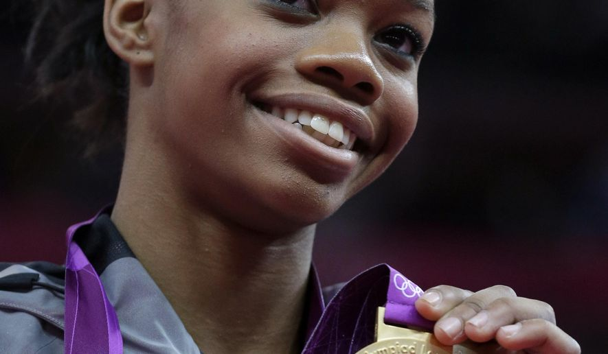 FILE - In this Aug. 2, 2012 file photo, U.S. gymnast Gabrielle Douglas displays her gold medal during the artistic gymnastics women's individual all-around competition at the 2012 Summer Olympics in London. Using a data-processing program to forcecast Olympic results, United States-based Gracenote - a sports and entertainment data provider - estimates the United States will top the overall medal table with 102 in the Rio de Janeiro Olympics. (AP Photo/Julie Jacobson, File)