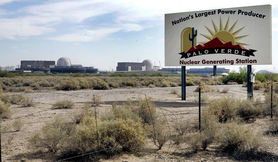 FILE - This Nov. 2, 2007, image shows the Palo Verde Nuclear Generating Station in Wintersburg, Ariz. The value of power purchased from one of the plant's units by Public Service Co. of New Mexico has come into question as the New Mexico utility seeks a rate hike for its customers. (AP Photo/Ross D. Franklin)