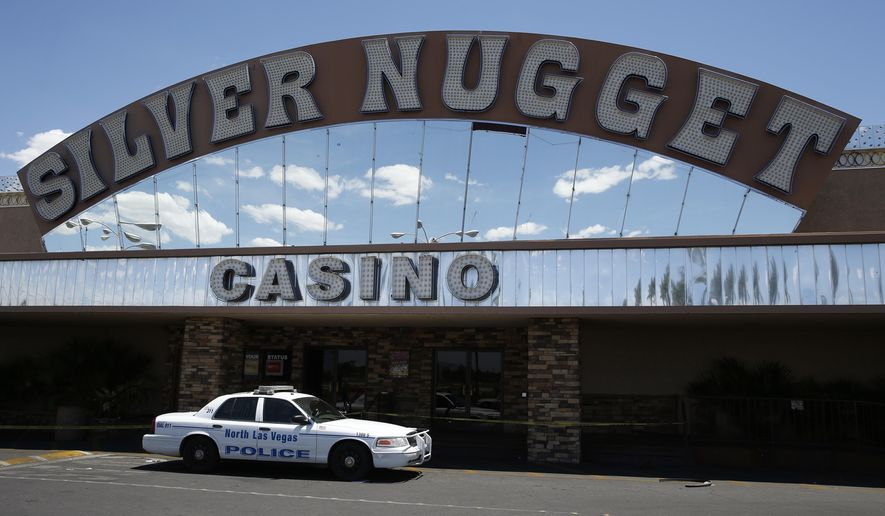 A North Las Vegas police car blocks the entrance to the Silver Nugget casino, Thursday, May 19, 2016, in North Las Vegas, Nev. North Las Vegas police officers were involved in a fatal shooting at the casino Thursday morning. (AP Photo/John Locher)