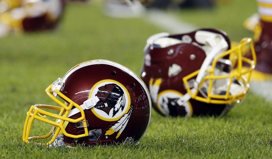 In this Dec. 26, 2015, file photo, a Washington Redskins helmet sits on the field as players warm-up before an NFL football game against the Philadelphia Eagles in Philadelphia. A recent national poll, conducted by the Washington Post, finds that nine of 10 Native Americans aren't offended by the Washington Redskins name.  A federal judge ordered the cancellation of the Redskins' trademark registration in July, ruling that their name may be disparaging to Native Americans. The club is appealing. (AP Photo/Matt Rourke, File)  **FILE**