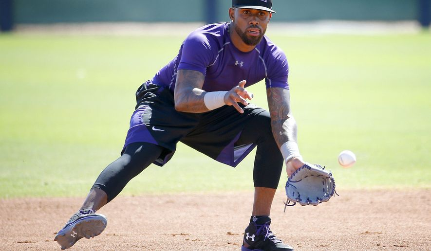 Colorado Rockies' Jose Reyes runs drills during an extended spring training, Thursday, May 19, 2016, at the Rockies' facility in Scottsdale, Ariz. Reyes was working out for the first time after being suspended under MLB domestic-violence policy. (AP Photo/Matt York)