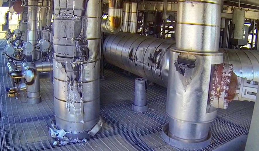 This photo provided by the San Bernardino County, Calif., Fire Department shows damage to the interior of a solar generating tower, which authorities say was caused by misaligned mirrors causing a small fire that shut down a generating tower at the Ivanpah Solar Power Facility, the world's largest solar power plant, in Nipton, Calif., near Primm, Nev., on the California-Nevada border Thursday, May 19, 2016.(San Bernardino County Fire Department via AP)