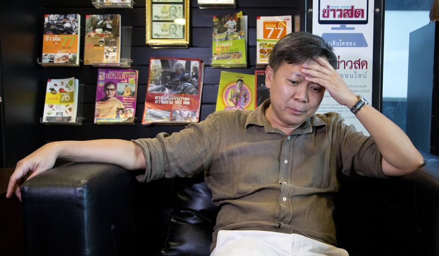 "In this May 10, 2016 photo, Pravit Rojanaphruk, a Thai journalist who is one of the Thai junta's prominent critics gestures during an interview with the Associated Press in Bangkok, Thailand. ""As a journalist, there's been a lot of self-censorship as well as the arbitrary detention of those who refuse to stop calling this regime illegitimate. I have been detained without charges twice."" (AP Photo/Mark Baker)"