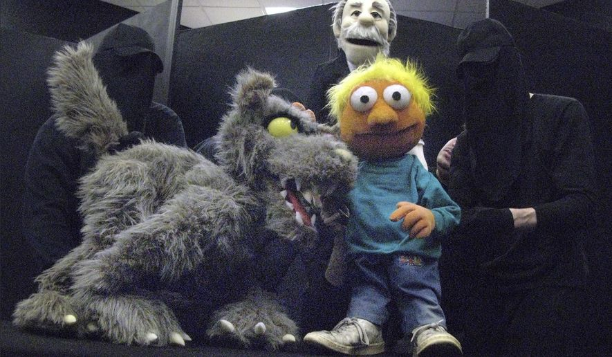 "In this Monday, May 16, 2016 photo, puppeteers demonstrate their Peter and the Wolf puppets at the University of Connecticut in Storrs, Conn. The students from UConn's Puppet Arts program will perform the show, ""Puppets Take the Pops,"" with the Boston Pops on Saturday, May 21, 2016, at Symphony Hall in Boston. (AP Photo/Pat Eaton-Robb)"