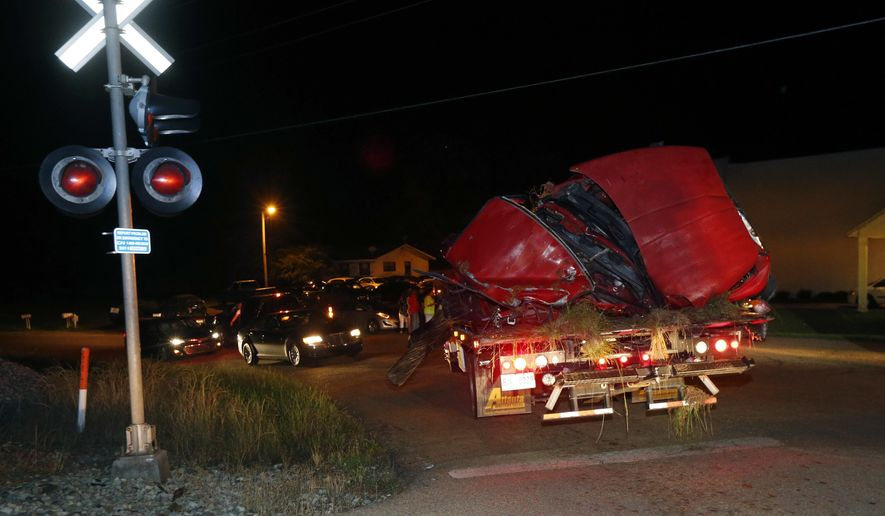 """The remains of a pickup truck that collided with Amtrak's """"City of New Orleans"""" passenger train in Flora, Miss., is removed Wednesday night, May 18, 2016. The Madison County Sheriff's Office confirmed the evening accident, but would not confirm any deaths, saying the Flora Police Department is investigating. (AP Photo/Rogelio V. Solis)"""