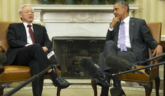 In this photo gtaken Juky 7, 2015, President Barack Obama meets with Vietnamese Communist party secretary general Nguyen Phu Trong in the Oval Office of the White House in Washington. President Barack Obama could lift an embargo on arms sales when he makes his first visit to Vietnam next week. That would remove a final vestige of wartime animosity but would not please China which views growing U.S. defense ties in its backyard with deep suspicion as tensions rise in the disputed South China Sea.  (AP Photo/Evan Vucci)