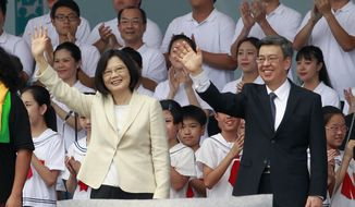 New Taiwan's President Tsai Ing-wen, left, and Vice President Chen Chien-jen wave during their inauguration ceremonies in Taipei, Taiwan, Friday, May 20, 2016. Taiwan inaugurated Tsai as its first female president on Friday, returning the pro-independence Democratic Progressive Party to power amid new concerns over increasingly fractious relations with Beijing and a flagging economy. (AP Photo/Chiang Ying-ying)