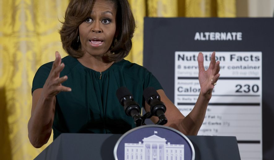 First lady Michelle Obama speaks in the East Room of the White House in Washington on Feb. 27, 2014, about helping parents and other consumers make healthier choices as part of her Let's Move program. The Obama administration is proposing new food labels that would make it easier to know about calories and added sugars, a reflection of the shifting science behind nutrition. (Associated Press) **FILE**
