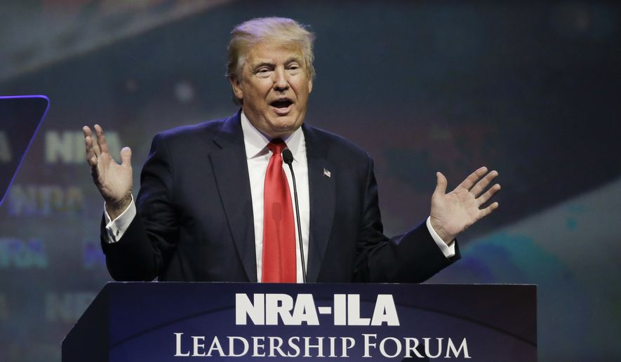 Then-Republican presidential candidate Donald Trump speaks at the National Rifle Association convention in Louisville, Ky., on May 20, 2016. (Associated Press) ** FILE **