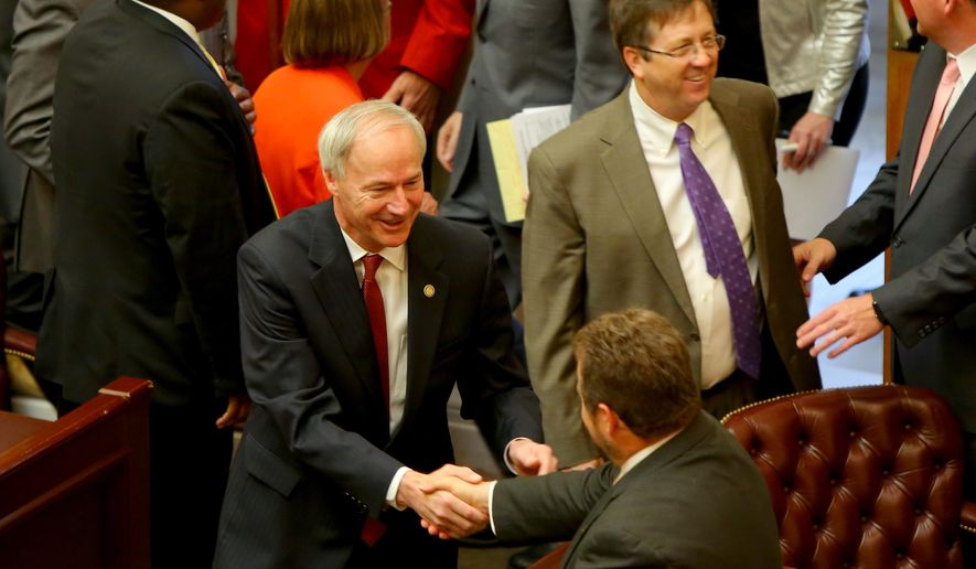 Gov. Asa Hutchinson, center, greets legislators before his address to  a joint session of the Legislature as the 90th General Assembly convenes for the first day of its third special session at the State Capitol in Little Rock, Ark. on Thursday, May 19, 2016. (Stephen B. Thornton/The Arkansas Democrat-Gazette via AP)  ARKANSAS TIMES OUT; ARKANSAS BUSINESS OUT; MANDATORY CREDIT