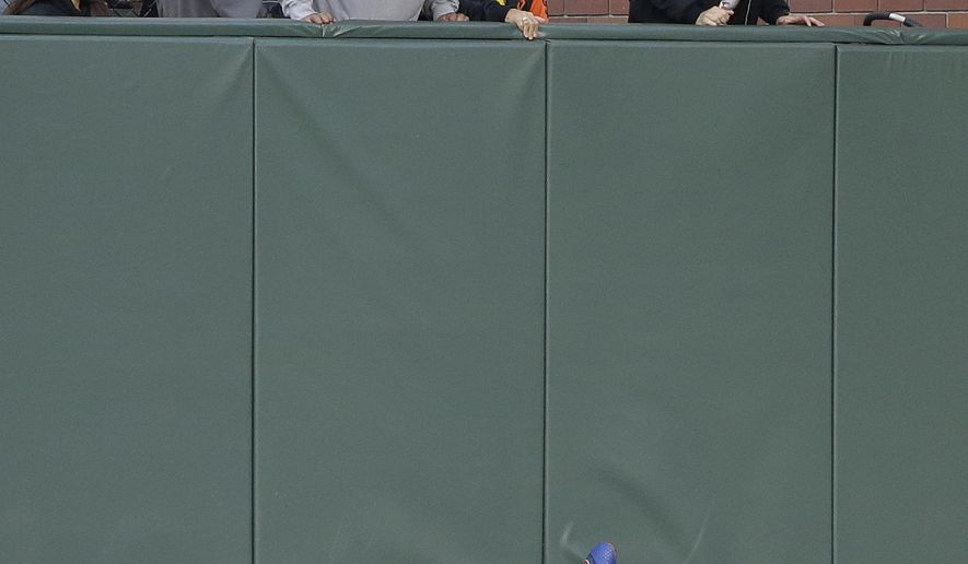 Chicago Cubs right fielder Jason Heyward crashes into the outfield wall after catching a fly ball hit by the San Francisco Giants' Denard Span in the first inning of a baseball game Friday, May 20, 2016, in San Francisco. Heyward was injured on the play and left the game. (AP Photo/Eric Risberg)