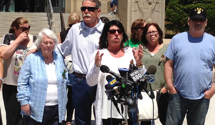 Sandra Lonnborg, center, speaks to the media outside the Nassau County Courthouse in Mineola, N.Y., on Friday, May 20, 2016. Lonnborg's daughter, Carly, was among five teenagers killed in a May 2014 car crash involving drag racing. She spoke after the sentencing of Cory Gloe, one of the drivers involved in the drag race. John Lonnborg, Carly's father, far right, and Carly Lonnborg's grandmother, Roseanna McGlone, center left, listen. (AP Photo/Frank Eltman)