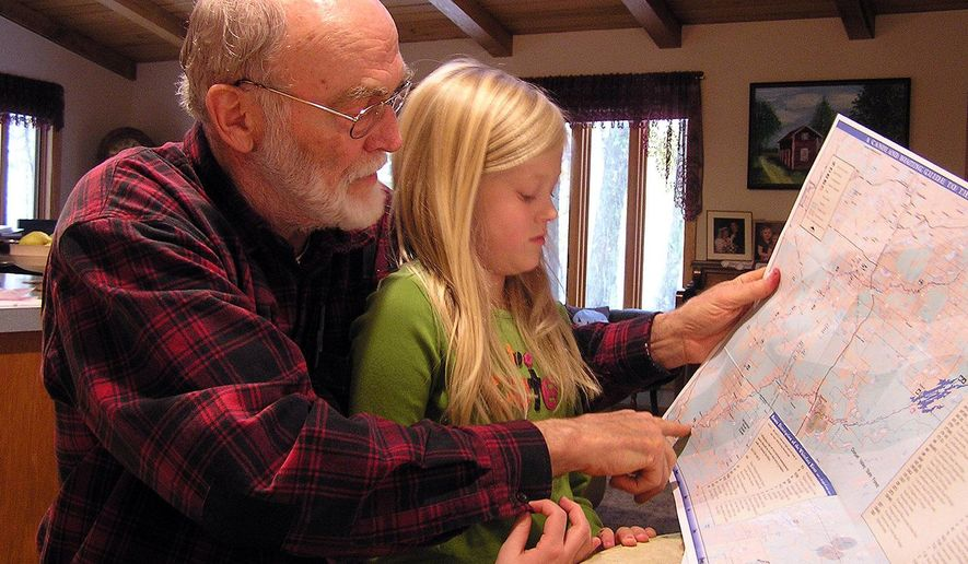 FOR RELEASE SATURDAY, MAY 21, 2016, AT 12:01 A.M. CDT. - This photo taken Oct. 22, 2009, shows retired biology teacher Leonard Anderson and his granddaughter Kylli, looking at a map to see where she caught a big catfish the summer before. Kylli wanted to eat the fish, but the St. Louis River has mercury advisories, warning pregnant women and young children not to eat certain fish. Anderson says if Minnesota allows copper-nickel mining, the mercury in the fish will only get worse. (Stephanie Hemphill/Minnesota Public Radio via AP) MANDATORY CREDIT