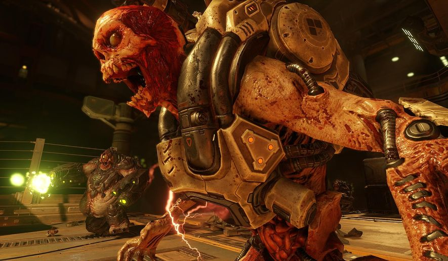 "This image released by Bethesda Softworks shows a scene from the video game, ""Doom."" (Bethesda Softworks via AP)"